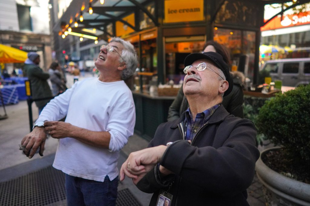 Photo: Mr. Schneider, 79, right, and Forest Markowitz, 68, confirming the time was right on a clock they were working on in Herald Square Park.
